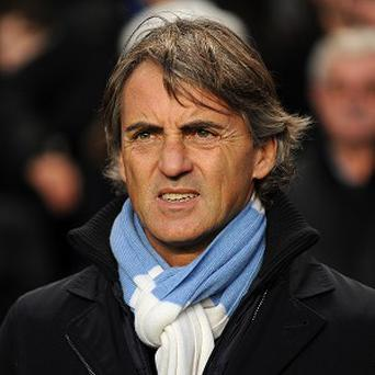 Roberto Mancini's City would go level on points with United if they win on Sunday