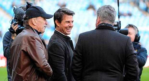 Actors Robert Duvall and Tom Cruise with Sky Sports correspondant Geoff Shreeves pitchside before kick-off during the Barclays Premier League match at the Etihad Stadium, Manchester.