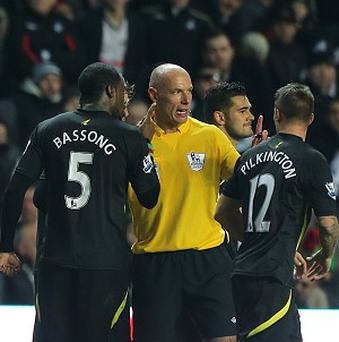 Sebastien Bassong, left, told referee Howard Webb that he believed he had been the victim of a racist gesture