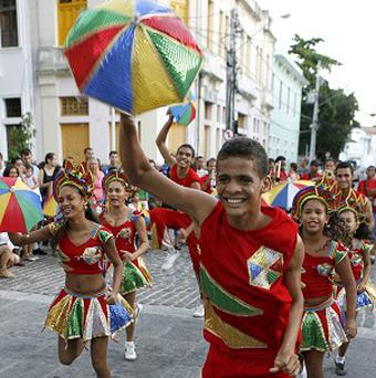 Members of the Bloco de Frevo group perform during a carnival parade in Olinda in Brazil's northern Pernambuco state (AP)