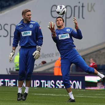Rob Green, left, admitted Julio Cesar's, right, arrival at QPR was a shock