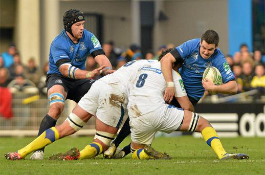 Jonathan Sexton, Leinster, supported by team-mate Sean O'Brien, is tackled by Clermont's Nathan Hines, left, and Damien Chouly. Photo: Sportsfile