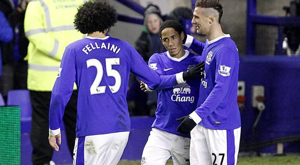 Everton's Steven Pienaar (centre) celebrates scoring his side's first goal of the game with teammates Marouane Fellaini (left) and Apostolos Vellios (right). Photo: PA
