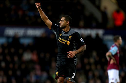 Liverpool's Glen Johnson celebrates scoring the opening goal against West Ham at Upton Park. Photo: PA