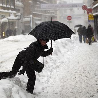 A pedestrian copes with heavy snow in downtown Zagreb, Croatia (AP)