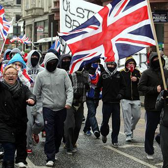 Loyalists in Belfast city centre protesting against restrictions on flying the Union flag