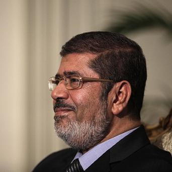 Egyptian President Mohammed Morsi has made concessions following protests (AP)
