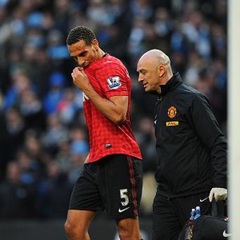 The FA has opened an investigation into an incident involving Rio Ferdinand, left, against Manchester City
