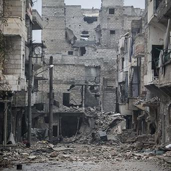 Damaged buildings are seen along a desolate street after several weeks of intense battles in the Amarya district of Aleppo, Syria (AP)