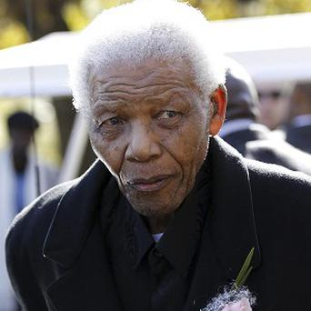 Former South African president Nelson Mandela is in hospital for a third day (AP Photo)