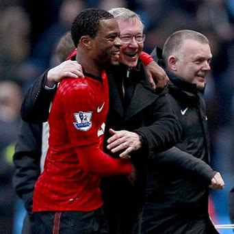 Patrice Evra, left, believes Sir Alex Ferguson would not let him leave Manchester United