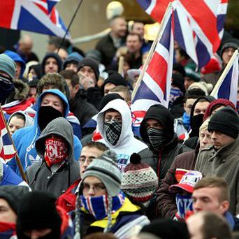 Loyalist protesters in Belfast city centre protest against new restrictions on flying the Union flag