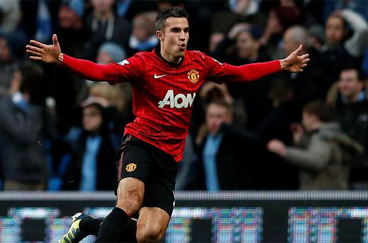 Manchester United's Robin Van Persie celebrates his goal against Manchester City. Photo: Reuters
