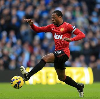 Patrice Evra, pictured, says Sir Alex Ferguson will sack his stars if they blow their title chances this season