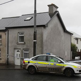 Gardai at the scene of Shane Rossiter's shooting in October, 2012.