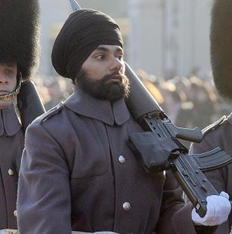 Jatenderpal Singh Bhullar has become the first person to guard the Queen wearing a turban instead of a traditional bearskin