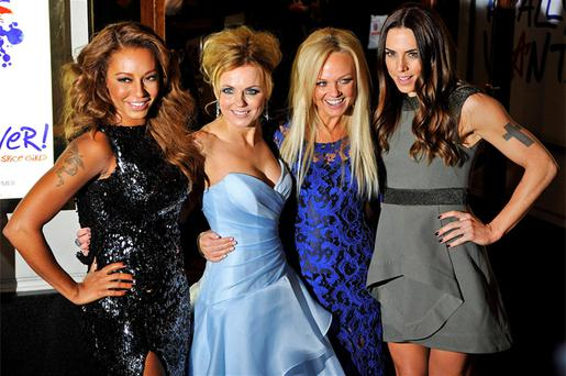 Spice Girl members Melanie Brown (L-R), Geri Halliwell, Emma Bunton and Melanie Chisholm arrive for the premiere of the musical 'Viva Forever!', based on the music of the Spice Girls, in central London. Photo: Reuters
