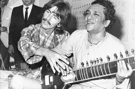 George Harrison, of the Beatles sits cross-legged with his musical mentor, Ravi Shankar. Photo: AP