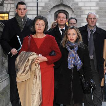 Pat Finucane's widow Geraldine arrives with her children John (left), Michael (centre) and Katherine at the Houses of Parliament in central London to read the review of the report into the loyalist murder of Belfast solicitor Pat Finucane which will be published later today. Photo: PA