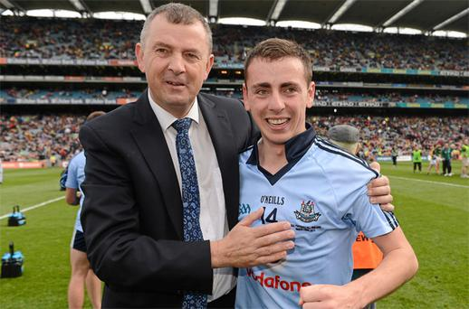 Dublin chief executive John Costello with his son Cormac following Dublin's victory over Meath in this year's All-Ireland MFC final