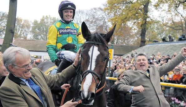 In happier times – owner Clive Smith (far left) celebrates with Paul Nicholls after Ruby Walsh rode Kauto Star to victory in the 2011 Betfair Chase at Haydock