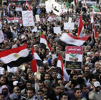 Supporters of Egyptian President Mohammed Morsi chant slogans during a demonstration in Cairo (AP)
