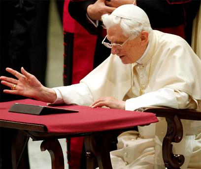 The pope sending his first tweet on a tablet computer. Photo: Reuters