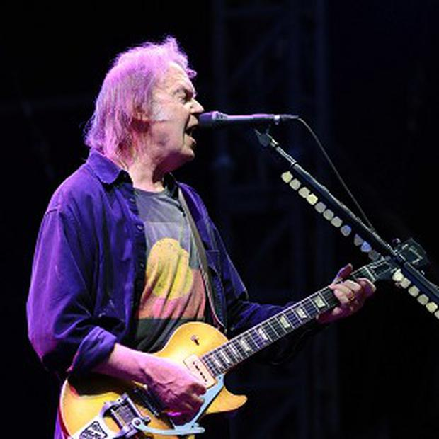 Neil Young will perform with Crazy Horse in the UK next year