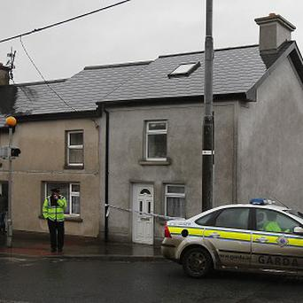 Gardai seal off the scene of the fatal shooting in the village of Golden, near Clonmel