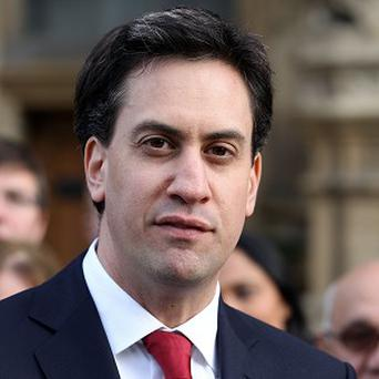 Labour leader Ed Miliband has called for a public inquiry over the killing of Pat Finucane