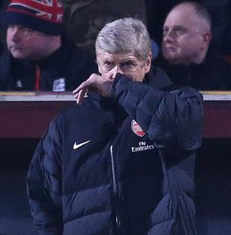 Arsenaln boss Arsene Wenger has been urged by fan group the AST to 'change direction'