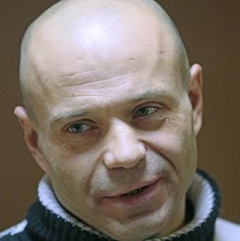 Former police officer Dmitry Pavlyuchenko is accused of helping track journalist Anna Politkovskaya and assisting her murderers (AP)
