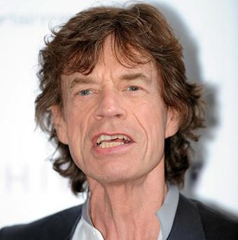 Almost a dozen passionate letters sent by Sir Mick Jagger to his secret lover in the summer of 1969 have sold at auction
