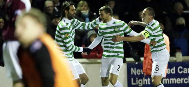 Celtic's Adam Matthews (centre)celebrates his goal with team mate Georgios Samaras (left) and Scott Brown (right) during the Scottish Cup Fourth Round Replay match at Gayfield Park, Arbroath. PRESS ASSOCIATION Photo. Picture date: Wednesday December 12, 2012. Photo credit should read: Danny Lawson/PA Wire. EDITORIAL USE ONLY