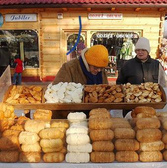 A street vendor selling regional smoked cheese 'oscypek ' in Zakopane, Poland (AP)