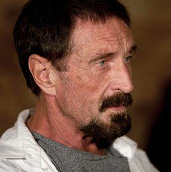 John McAfee says he is going to catch a flight to Miami, Florida (AP)