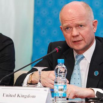 William Hague at a press conference following the meeting of the Friends of the Syrian People in Morocco (AP)