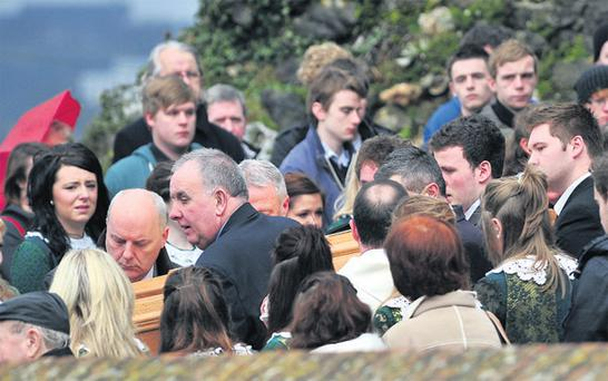 Mourners carry the coffin of Deirdre Lynch at the Church of Our Lady of Lourdes, Ballinlough, Cork