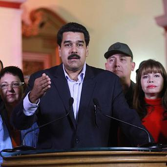 Venezuela vice president Nicolas Maduro called for unity in the country as it faces 'complex and difficult scenarios' (AP)