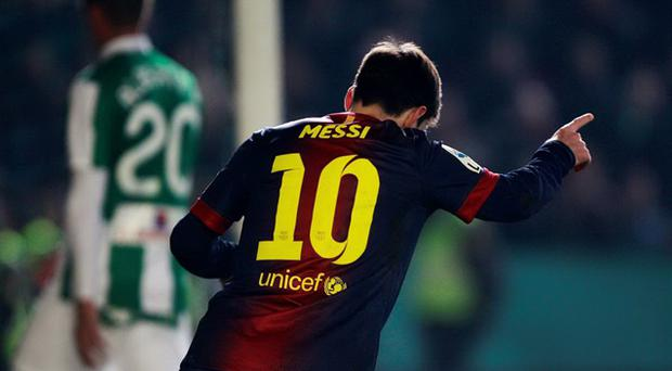 Barcelona's Lionel Messi celebrates after scoring to extend his record-breaking tally for 2012 to 88