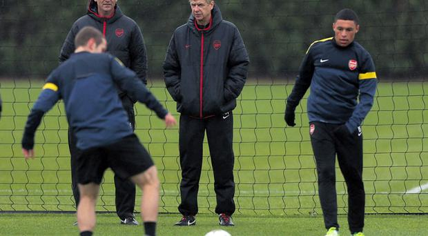 Arsenal manager Arsene Wenger and coach Steve Bould watch Jack Wilshere and Alex Oxlade-Chamberlain in training last month, however, stories have emerged of Bould's limited role in training