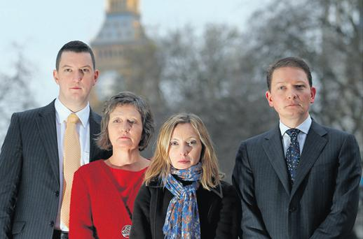 Geraldine Finucane with her sons Michael (right) and John Finucane and daughter Katherine in Westminster, London
