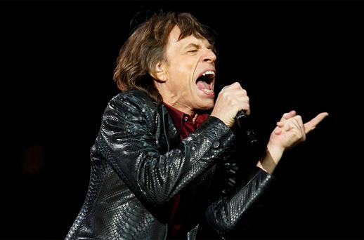 Mick Jagger of the Rolling Stones performs during the '12-12-12' benefit concert for victims of Superstorm Sandy at Madison Square Garden in New York. Photo: Reuters