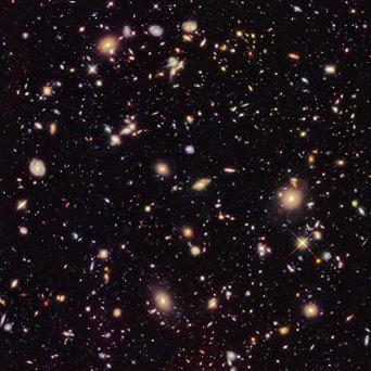 This image provided by Nasa and taken by the Hubble Space Telescope shows previously unseen early galaxies including the oldest one (AP/Nasa)