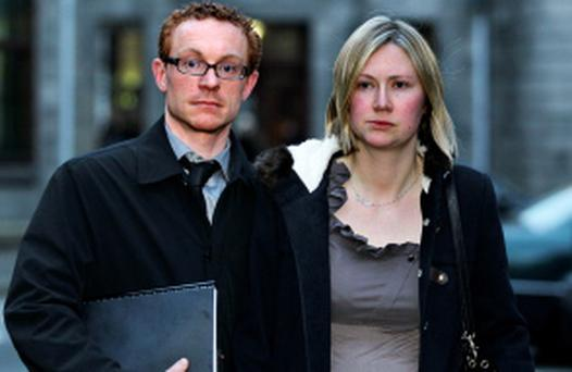 Ni Chunchubhair: (Fiona); personal injuries action for damages against the HSE arising from the death of baby Aodh Cotter, High Court, Dublin, (13/12/12)****see Hi Ct story.Pic. shows: Fiona Ni Chunchubhair and her husband, Stephen Cotter of Killarney, Co Kerry leaving court yesterday (Thurs.) on the opening day of the action for damages.(Pic: CourtPix.)