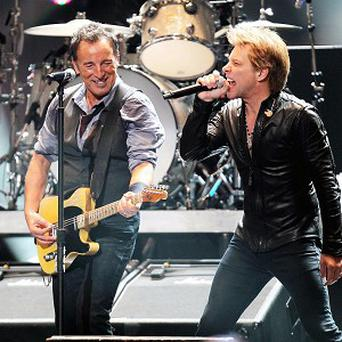 Bruce Springsteen and Jon Bon Jovi perform during the Sandy benefit gig in New York (AP Photo/Starpix, Dave Allocca)