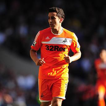 Neil Taylor has penned a new deal at Swansea despite his ankle injury