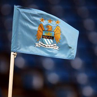 Manchester City's loss is less than half of the amount from 12 months ago