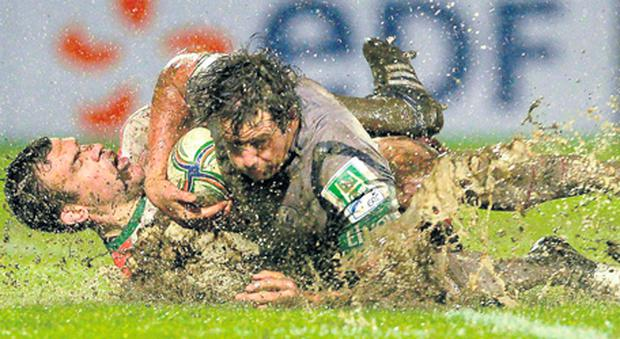 Connacht's Mike McCarthy is tackled by Damien Traille of Biarritz during the Heineken Cup clash in France.