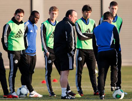 Benitez speaks to his players at a training session for the Club World Cup final.